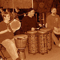 Left to right, Toni Kellar, Andy Hall, and Steve Kellar drum for the dancers at a Groove Project Drum & Dance, Marietta, OH.